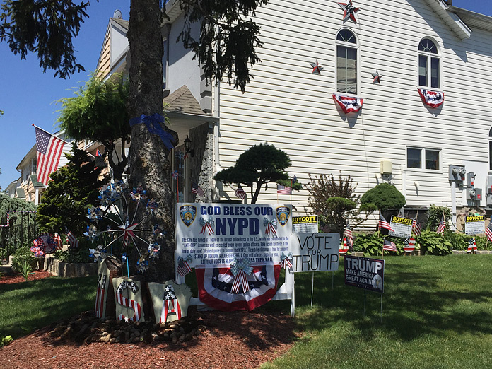 House in Staten Island with Trump signs and American flags